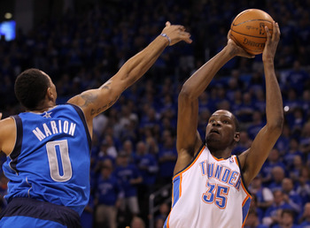 OKLAHOMA CITY, OK - MAY 23:  Kevin Durant #35 of the Oklahoma City Thunder shoots over Shawn Marion #0 of the Dallas Mavericks in the first quarter in Game Four of the Western Conference Finals during the 2011 NBA Playoffs at Oklahoma City Arena on May 23