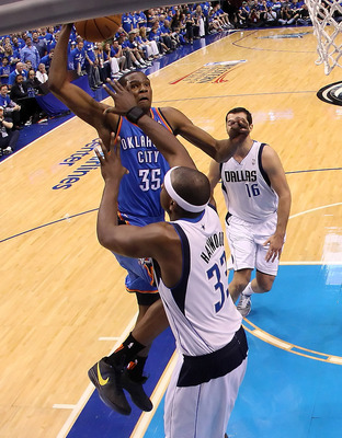 DALLAS, TX - MAY 19:  Kevin Durant #35 of the Oklahoma City Thunder dunks the ball over Brendan Haywood #33 of the Dallas Mavericks as Haywood is called for a foul in the first quarter in Game Two of the Western Conference Finals during the 2011 NBA Playo
