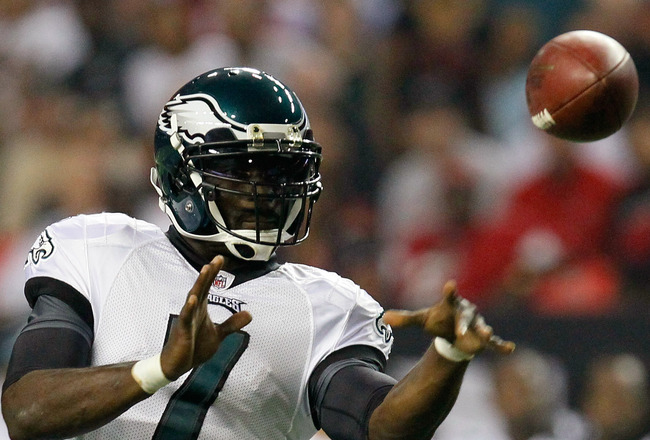 ATLANTA, GA - SEPTEMBER 18:  Michael Vick #7 of the Philadelphia Eagles tosses a pass against the Atlanta Falcons at Georgia Dome on September 18, 2011 in Atlanta, Georgia.  (Photo by Kevin C. Cox/Getty Images)