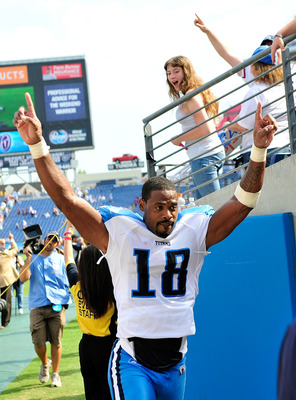 NASHVILLE, TN - SEPTEMBER 18:  Kenny Britt #18 of the Tennessee Titans celebrates as he leaves the field after a win over the Baltimore Ravens at LP Field on September 18, 2011 in Nashville, Tennessee. Tennessee won 26-13.  (Photo by Grant Halverson/Getty