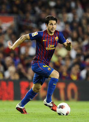 BARCELONA, SPAIN - SEPTEMBER 17:  Cesc Fabregas of FC Barcelona runs with the ball during the La Liga soccer match between FC Barcelona and CA Osasuna at Camp Nou Stadium on September 17, 2011 in Barcelona, Spain. FC Barcelona won 8-0.  (Photo by David Ra
