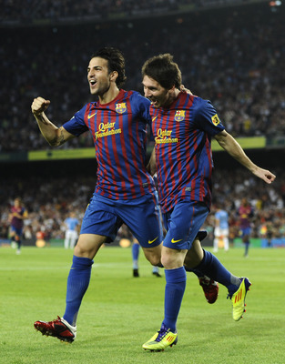 BARCELONA, SPAIN - SEPTEMBER 17:  Lionel Messi of FC Barcelona (R) celebrates with his teammate Cesc Fabregas after scoring his first team's goalduring the La Liga soccer match between FC Barcelona and CA Osasuna at Camp Nou Stadium on September 17, 2011