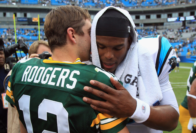 CHARLOTTE, NC - SEPTEMBER 18:  Cam Newton #1 talks to Aaron Rodgers #12 of the Green Bay Packers after loosing 30-23 against the Green Bay Packers at Bank of America Stadium on September 18, 2011 in Charlotte, North Carolina.  (Photo by Streeter Lecka/Get