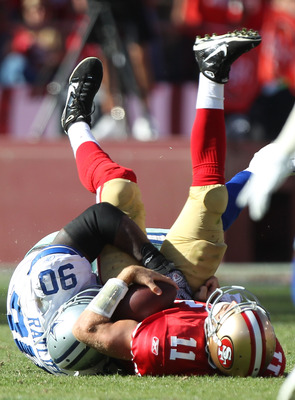 SAN FRANCISCO, CA - SEPTEMBER 18:  Alex Smith #11 of the San Francisco 49ers is sacked by Jay Ratliff #90 of the Dallas Cowboys at Candlestick Park on September 18, 2011 in San Francisco, California.  (Photo by Jed Jacobsohn/Getty Images)