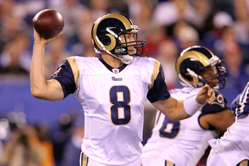 EAST RUTHERFORD, NJ - SEPTEMBER 19:  Sam Bradford #8 of the St. Louis Rams throws a pass against the New York Giants at MetLife Stadium on September 19, 2011 in East Rutherford, New Jersey.  (Photo by Al Bello/Getty Images)