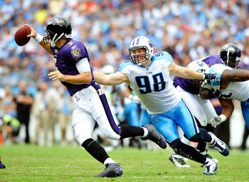 NASHVILLE, TN - SEPTEMBER 18:  Dave Ball #98 of the Tennessee Titans pressures quarterback Joe Flacco #5 of the Baltimore Ravens during the first half at LP Field on September 18, 2011 in Nashville, Tennessee.  (Photo by Grant Halverson/Getty Images)