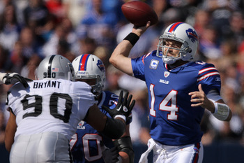 ORCHARD PARK, NY - SEPTEMBER 18: Ryan Fitzpatrick #14 of the Buffalo Bills throws a pass during an NFL game against the Oakland Raiders at Ralph Wilson Stadium on September 18, 2011 in Orchard Park, New York. (Photo by Tom Szczerbowski/Getty Images)