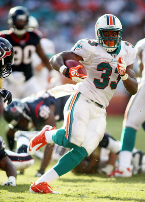 MIAMI GARDENS, FL - SEPTEMBER 18: Running back Daniel Thomas #33 of the Miami Dolphins runs against the Houston Texans at Sun Life Stadium on September 18, 2011 in Miami Gardens, Florida. The Texans defeated the Dolphins 23-13. (Photo by Marc Serota/Getty