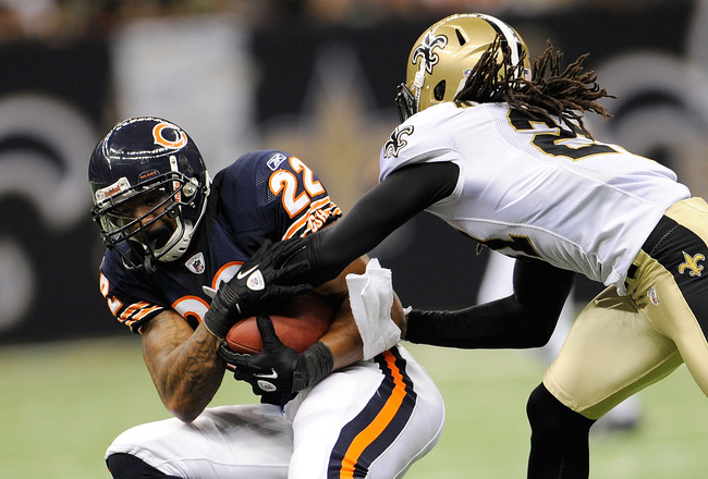 NEW ORLEANS, LA - SEPTEMBER 18: Matt Forte #22 of the Chicago Bears is brought down at the Louisiana Superdome on September 18, 2011 in New Orleans, Louisiana.  The Saints defeated the Bears 30-13.  (Photo by Stacy Revere/Getty Images)