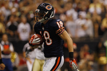 NEW ORLEANS, LA - SEPTEMBER 18:   Dane Sanzenbacher #18 of the Chicago Bears catches a touchdown pass during the game against the New Orleans Saints at Louisiana Superdome on September 18, 2011 in New Orleans, Louisiana.  (Photo by Chris Graythen/Getty Im