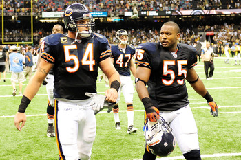 NEW ORLEANS, LA - SEPTEMBER 18:  Brian Urlacher #54 and Lance Briggs #55 of the Chicago Bears walk off the field after being defeated 30-13 by the New Orleans Saints at the Louisiana Superdome on September 18, 2011 in New Orleans, Louisiana.  (Photo by St