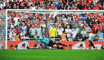 LONDON, ENGLAND - APRIL 19:  Tim Howard of Everton saves a penalty from Rio Ferdinand of Manchester United in the shoot out during the FA Cup sponsored by E.ON Semi Final match between Everton and Manchester United at Wembley Stadium on April 19, 2009 in