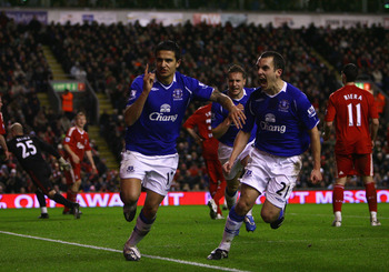 LIVERPOOL, UNITED KINGDOM - JANUARY 19:  Tim Cahill (L) of Everton celebrates scoring an equalising goal with team mate Leon Osman during the Barclays Premier League match between Liverpool and Everton at Anfield on January 19, 2009 in Liverpool, England.