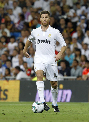MADRID, SPAIN - AUGUST 24:  Xabi Alonso of Real Madrid in action during the Santiago Bernabeu Trophy match between Real Madrid and Galatasaray at Estadio Santiago Bernabeu on August 24, 2011 in Madrid, Spain.  (Photo by Angel Martinez/Getty Images)