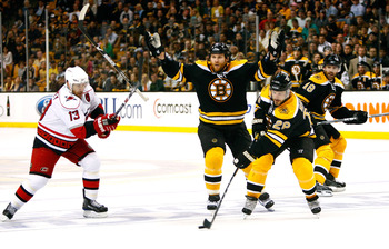 BOSTON - MAY 10: Michael Ryder #73 of the Boston Bruins breaks his stick as Ray Whitney #13 of the Carolina Hurricanes defends Mark Recchi #28 of the Boston Bruins during Game Five of the Eastern Conference Semifinal Round of the 2009 Stanley Cup Playoffs