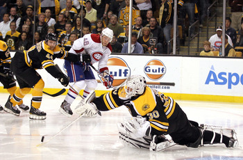 BOSTON, MA - APRIL 27:  Goalie Tim Thomas #30 of the Boston Bruins makes the save against Andrei Kostitsyn #46 of the Montreal Canadiens in Game Seven of the Eastern Conference Quarterfinals during the 2011 NHL Stanley Cup Playoffs at TD Garden on April 2