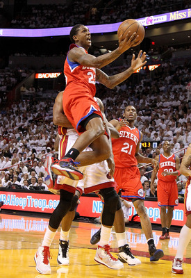 MIAMI, FL - APRIL 27:  Louis Williams #23 of the Philadelphia 76ers drives to the rim past LeBron James #6 of the Miami Heat  during game five of the Eastern Conference Quarterfinals in the 2011 NBA Playoffs at American Airlines Arena on April 27, 2011 in