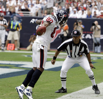 HOUSTON - SEPTEMBER 11:  Wide receiver Andre Johnson #80 of the Houston Texans scores on a pass in the back of the end-zone against the Indianapolis Colts at Reliant Stadium on September 11, 2011 in Houston, Texas. The Texans won 34-7.  (Photo by Bob Leve