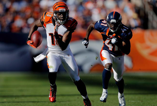 DENVER, CO - SEPTEMBER 18:  Wide receiver A.J. Green #18 of the Cincinnati Bengals runs after making a catch against Cornerback Cassius Vaughn #41 of the Denver Broncos during the third quarter at Sports Authority Field at Mile High on September 18, 2011