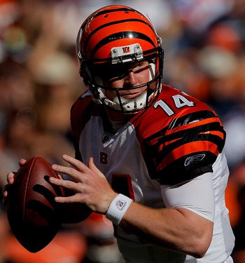 DENVER, CO - SEPTEMBER 18:  Quarterback Andy Dalton #14 of the Cincinnati Bengals looks for a receiver during the third quarter against the Denver Broncos at Sports Authority Field at Mile High on September 18, 2011 in Denver, Colorado. (Photo by Justin E