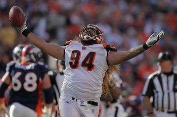 DENVER, CO - SEPTEMBER 18:  Domata Peko #94 of the Cincinnati Bengals celebrates after recovering a fumble by quarterback Kyle Orton #8 of the Denver Broncos at Invesco Field at Mile High on September 18, 2011 in Denver, Colorado.  (Photo by Doug Pensinge