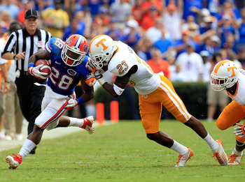 GAINESVILLE, FL - SEPTEMBER 17:  Running back Jeff Demps #28 of the Florida Gators attempts tu run past defensive back Prentiss Waggner #23 of the Tennessee Volunteers during a game at Ben Hill Griffin Stadium on September 17, 2011 in Gainesville, Florida
