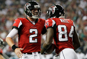 ATLANTA, GA - SEPTEMBER 18: Matt Ryan #2 of the Atlanta Falcons celebrates a touchdown with teammate Roddy White #84 against the Philadelphia Eagles at Georgia Dome on September 18, 2011 in Atlanta, Georgia.  (Photo by Kevin C. Cox/Getty Images)