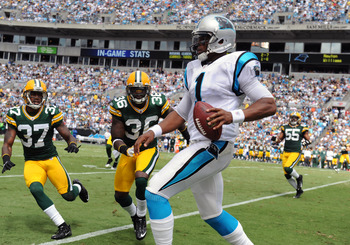 CHARLOTTE, NC - SEPTEMBER 18:  Quarterback Cam Newton #1 of the Carolina Panthers runs for a gain against the Green Bay Packers September 18, 2011 at Bank of America Stadium in Charlotte, North Carolina.  (Photo by Al Messerschmidt/Getty Images)