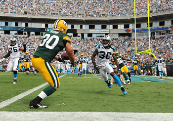 CHARLOTTE, NC - SEPTEMBER 18:  Fullback John Kuhn #30 of the Green Bay Packers drops a pass in the end zone against the Carolina Panthers September 18, 2011 at Bank of America Stadium in Charlotte, North Carolina.  (Photo by Al Messerschmidt/Getty Images)