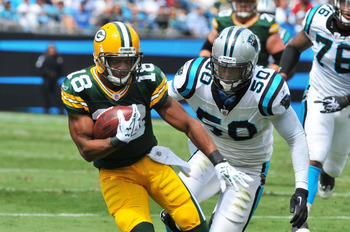CHARLOTTE, NC - SEPTEMBER 18:  Wide receiver Randall Cobb #18 of the Green Bay Packers runs away from linebacker James Anderson #50 of the Carolina Panthers September 18, 2011 at Bank of America Stadium in Charlotte, North Carolina.  (Photo by Al Messersc
