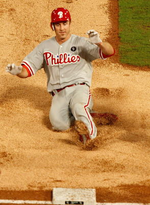 MIAMI GARDENS, FL - SEPTEMBER 03:  Chase Utley #26 of the Philadelphia Phillies heads to third on a triple during a game against the Florida Marlins at Sun Life Stadium on September 3, 2011 in Miami Gardens, Florida.  (Photo by Mike Ehrmann/Getty Images)