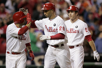 PHILADELPHIA, PA - SEPTEMBER 17: Raul Ibanez #29 of the Philadelphia Phillies is congratulated by Shane Victorino (L) as Chase Utley #26 follows after Ibanez hit a grand slam home run in the eighth inning as the Phillies defeated the St. Louis Cardinals 9