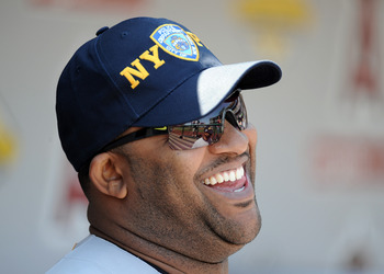 ANAHEIM, CA - SEPTEMBER 11:  CC Sabathia #52 of the New York Yankees wears a FDNY baseball cap before a pre-game ceremony recognizing the 10th anniversary of the September 11th attacks at Angel Stadium of Anaheim on September 11, 2011 in Anaheim, Californ