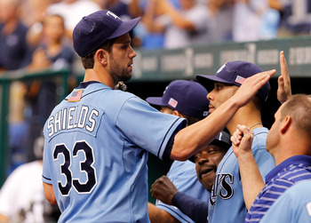 ST. PETERSBURG, FL - SEPTEMBER 11:  Pitcher James Shields #33 of the Tampa Bay Rays is congratulated after leaving the game in the ninth inning against the Boston Red Sox at Tropicana Field on September 11, 2011 in St. Petersburg, Florida.  (Photo by J. M