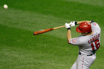 BALTIMORE, MD - SEPTEMBER 16: Hank Conger #16 of the Los Angeles Angels of Anaheim connects for a two RBI home run against the Baltimore Orioles during the ninth inning at Oriole Park at Camden Yards on September 16, 2011 in Baltimore, Maryland. The Oriol