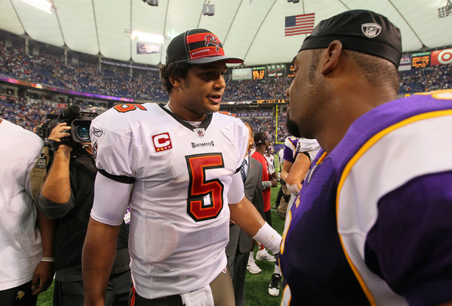MINNEAPOLIS, MN - SEPTEMBER 18:  Josh Freeman #5 of the Tampa Bay Buccaneers and Donovan McNabb #5 of the Minnesota Vikings meet on the field after the game at the Hubert H. Humphrey Metrodome on September 18, 2011 in Minneapolis, Minnesota.  (Photo by Ad