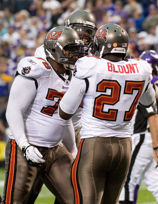 MINNEAPOLIS, MN - SEPTEMBER 18: E.J. Wilson #78 and LeGarrette Blount #27 of the Tampa Bay Buccaneers celebrate a touchdown against the Minnesota Vikings in the fourth quarter on September 18, 2011 at Hubert H. Humphrey Metrodome in Minneapolis, Minnesota
