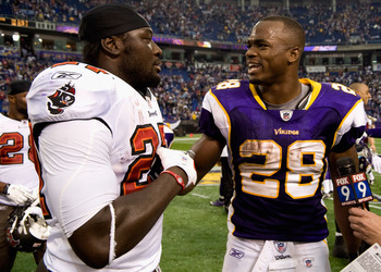 MINNEAPOLIS, MN - SEPTEMBER 18: LeGarrette Blount #27 of the Tampa Bay Buccaneers and Adrian Peterson #28 of the Minnesota Vikings speak following the Buccaneers win on September 18, 2011 at Hubert H. Humphrey Metrodome in Minneapolis, Minnesota. The Bucc