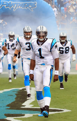 CHARLOTTE, NC - SEPTEMBER 18:   Cam Newton #1 of the Carolina Panthers leads the team out before their game against the Green Bay Packers at Bank of America Stadium on September 18, 2011 in Charlotte, North Carolina.  (Photo by Streeter Lecka/Getty Images
