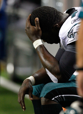 ATLANTA, GA - SEPTEMBER 18:  Michael Vick #7 of the Philadelphia Eagles sits on the sidelines after being injured in the third quarter against the Atlanta Falcons at Georgia Dome on September 18, 2011 in Atlanta, Georgia.  (Photo by Kevin C. Cox/Getty Ima