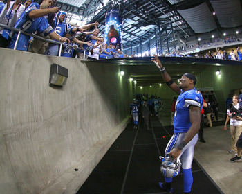 DETROIT, MI - SEPTEMBER 18:  Calvin Johnson #81 of the Detroit Lions waves to the cheering fans on his way off the field after a NFL game against the Kansas City Chiefs at Ford Field on September 18, 2011 in Detroit, Michigan.  The Lions won 48-3 (Photo b
