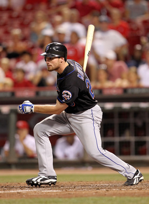 CINCINNATI, OH - JULY 27:  Daniel Murphy #28 of the New York Mets hits a double during the game against the Cincinnati Reds at Great American Ball Park on July 27, 2011 in Cincinnati, Ohio.  (Photo by Andy Lyons/Getty Images)