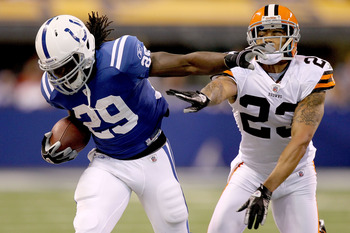 INDIANAPOLIS, IN - SEPTEMBER 18:  Joseph Addai #29 of the Indianapolis Colts carries the ball against Joe Haden #23 of the Cleveland Browns at Lucas Oil Stadium on September 18, 2011 in Indianapolis, Indiana.  (Photo by Matthew Stockman/Getty Images)