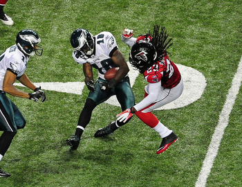 ATLANTA - SEPTEMBER 18: Jeremy Maclin #18 of the Philadelphia Eagles is tackled by Dunta Robinson #23 of the Atlanta Falcons at the Georgia Dome on September 18, 2011 in Atlanta, Georgia. Robinson would be penalized for leading with his helmet. (Photo by