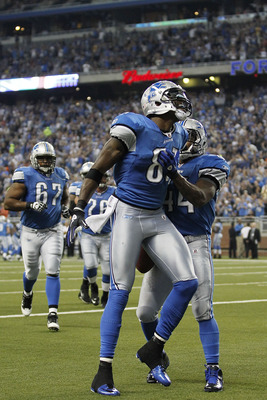 DETROIT, MI - SEPTEMBER 18: Calvin Johnson #81 of the Detroit Lions celebrates with Jahvid Best #44 after scoring on an 18 yard touchdown pass from Matthew Stafford #9 during the first quarter of the game against the Kansas City Chiefs at Ford Field on Se