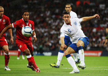 LONDON, ENGLAND - SEPTEMBER 06:  Gary Cahill of England clears the ball during the UEFA EURO 2012 group G qualifying match between England and Wales at Wembley Stadium  on September 6, 2011 in London, England.  (Photo by Bryn Lennon/Getty Images)