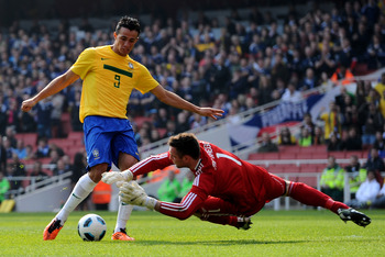 LONDON, ENGLAND - MARCH 27:   Leandro Damiao of Brazil has his effort stopped by Allan McGregor of Scotland during the International friendly match between Brazil and Scotland at Emirates Stadium on March 27, 2011 in London, England.  (Photo by Mike Hewit