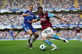 LONDON, ENGLAND - APRIL 23:  Wayne Bridge of West Ham clears the ball as Branislav Ivanovic of Chelsea cloese in during the Barclays Premier League match between Chelsea and West Ham United at Stamford Bridge on April 23, 2011 in London, England.  (Photo