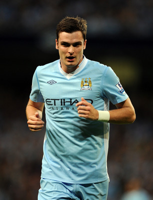 MANCHESTER, ENGLAND - AUGUST 15:  Adam Johnson of Manchester City looks on during the Barclays Premier League match between Manchester City and Swansea City at Etihad Stadium on August 15, 2011 in Manchester, England.  (Photo by Chris Brunskill/Getty Imag