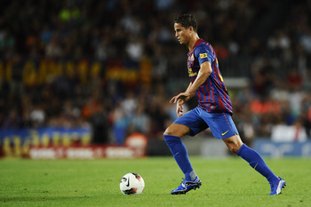 BARCELONA, SPAIN - SEPTEMBER 17:  Ibrahim Afellay of FC Barcelona runs with the ball during the La Liga soccer match between FC Barcelona and CA Osasuna at Camp Nou Stadium on September 17, 2011 in Barcelona, Spain. FC Barcelona won 8-0.  (Photo by David